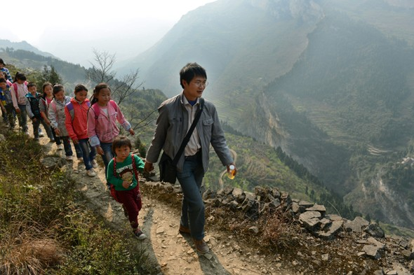 The world's most risky school run? Children walk along precarious cliff path