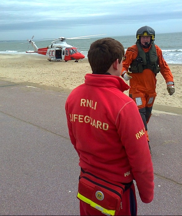 Kite surfer critically ill after wind drags him 100ft off beach into building