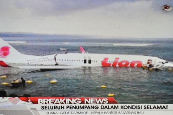 Plane misses runway at Bali airport and lands in sea, passengers survive