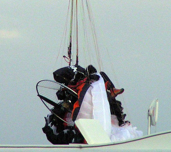 Pictures: Dramatic moment a hang glider crashes into 11,000 volt cable