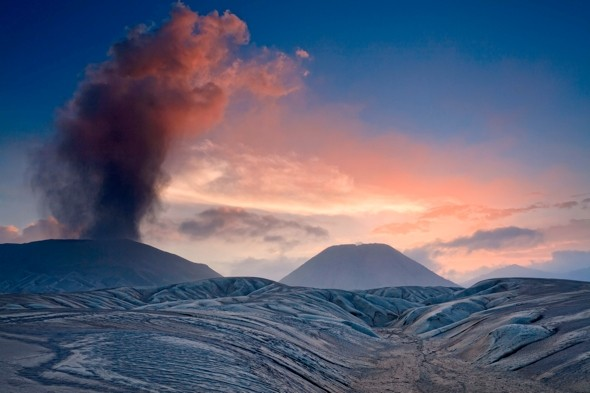 Amazing pic shows volcano billowing red smoke at sunrise