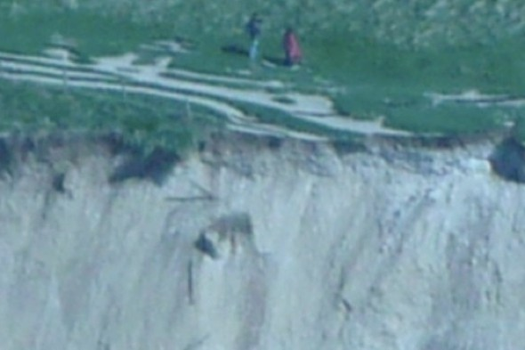 Couple spotted walking close to cliff after 'massive' landslide in Dorset