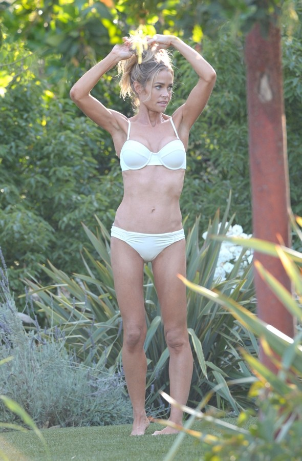Denise Richards lets her hair down poolside at Beverly Hills Hotel