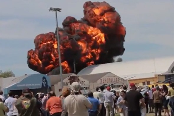 Video: Horror at Madrid air show as historic plane crashes into hanger