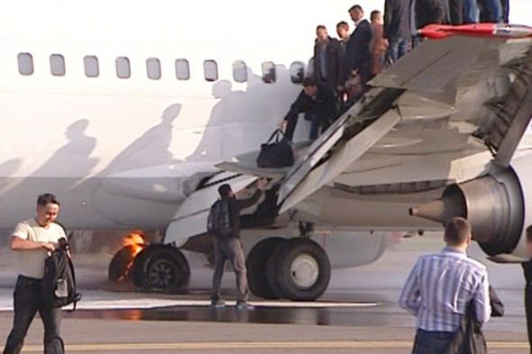 Plane lands in Russia after undercarriage catches fire