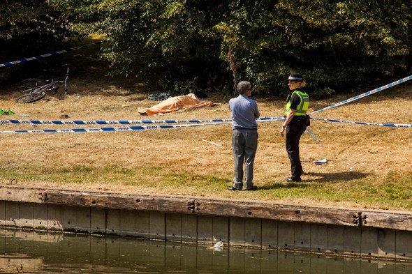 Tourists sunbathe just yards from dead bodies at River Cam