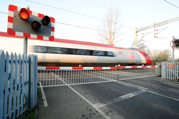 Dad 'listening to music' killed by train at level crossing