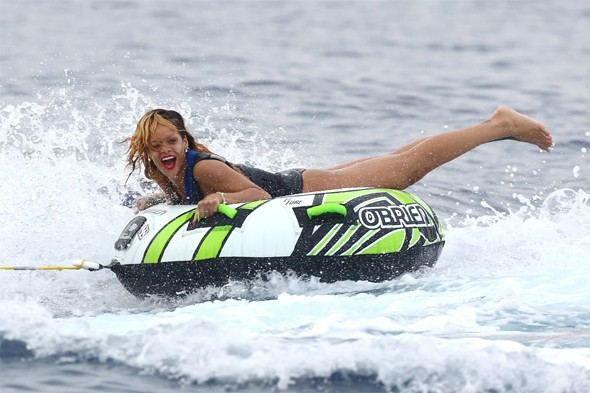Rihanna and Cara Delevingne let their hair down on rubber rings