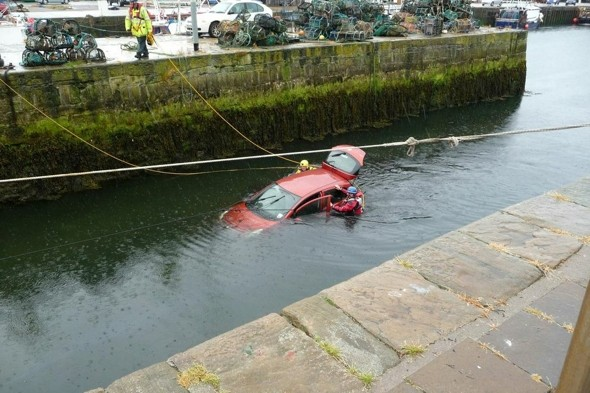 'Hero' binmen rescue woman and dog after car plunges 20ft into sea