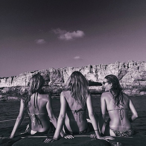 Rosie Huntington-Whiteley shows off washboard abs on girls' holiday in Ibiza