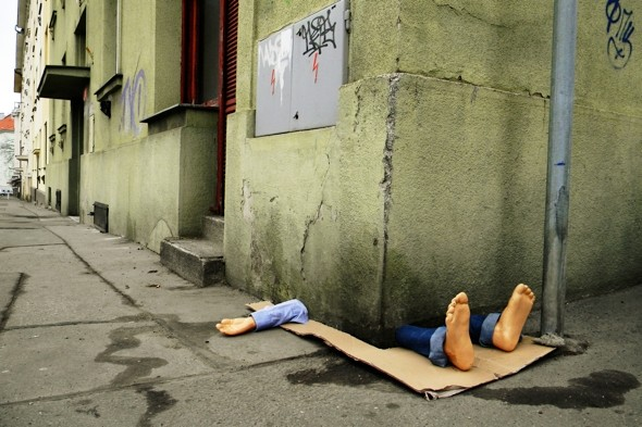 Squashed 'body under building' leaving passersby bemused