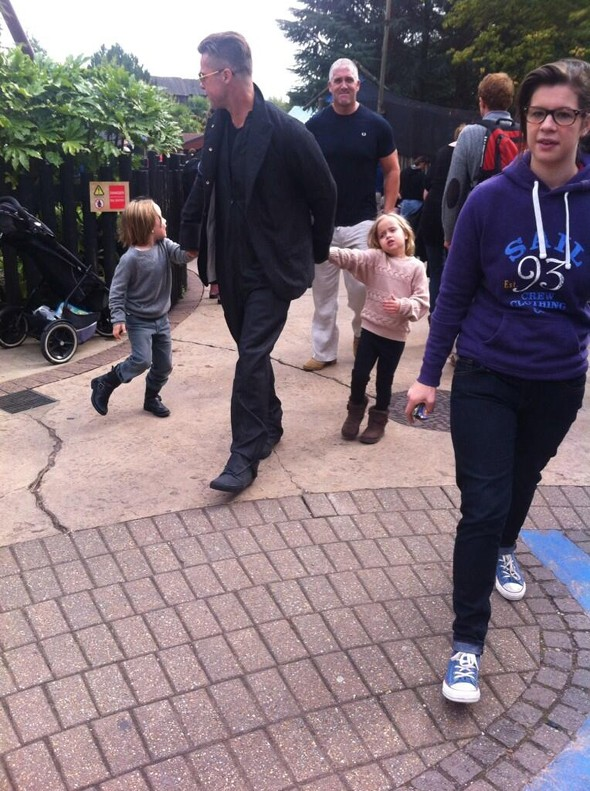 Brad Pitt pictured on day out with twins at Legoland Windsor