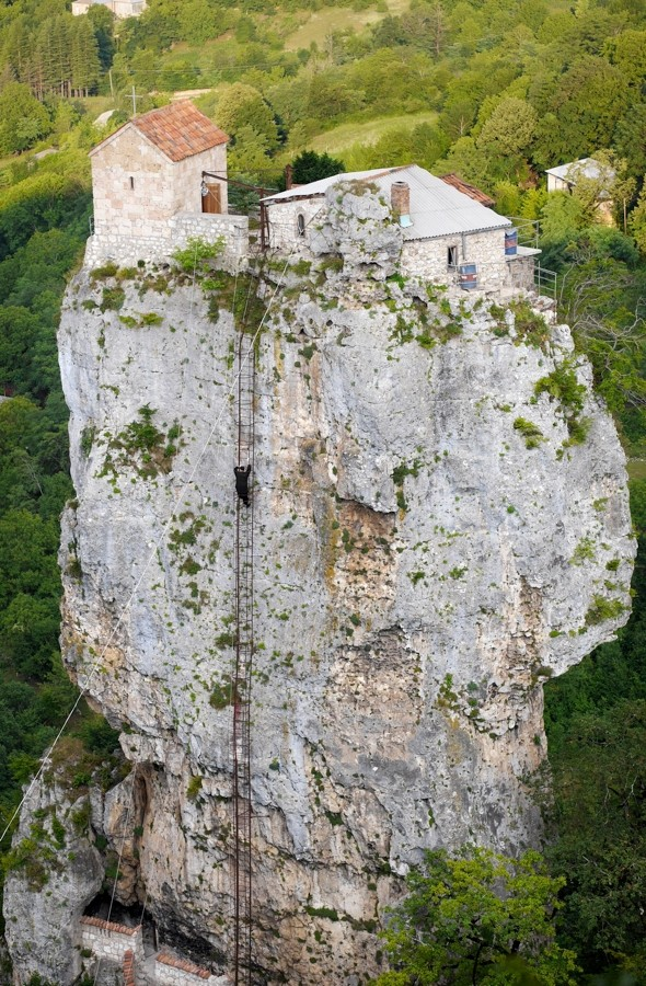 Meet the monk who lives on top of a 130ft cliff