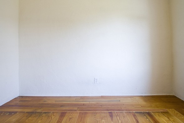 Woman returns from holiday to find home stripped bare