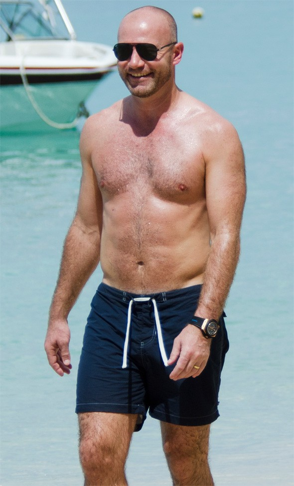 Alan Shearer shows off toned body on holiday in Barbados