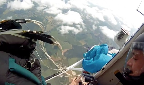 Skydiver inches from death as parachute opens early - next to helicopter blades