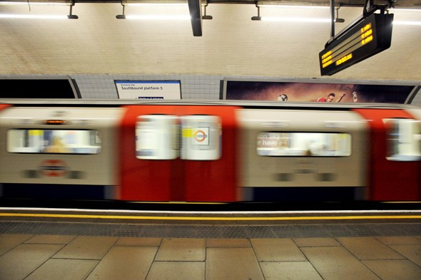 Tube train doors open between stations with baby close to exit