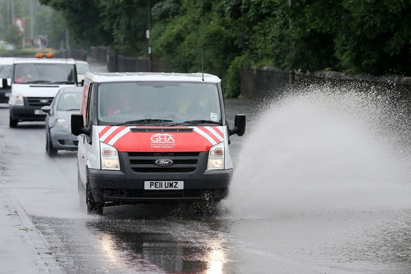 Two motorists killed as storms hit Britain