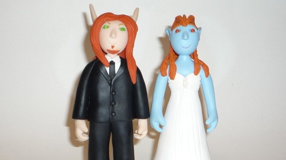 Elf and troll wedding cake topper