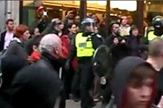 riot police officer in crowd