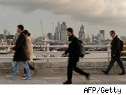 Commuters walk over bridge in London