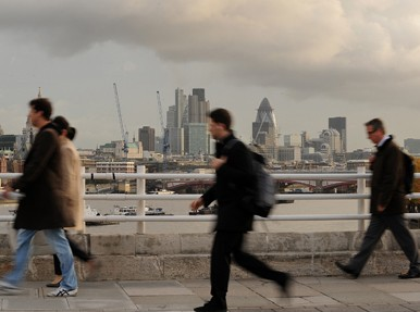Commuters on bridge in London