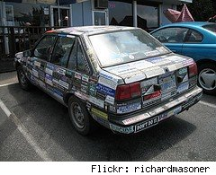 bumper sticker covered car