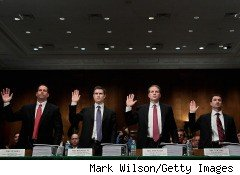 Federal prosecutors are conducting a criminal investigation into whether Goldman Sachs Group or its employees -- four pictured here testifying before Congress -- committed securities fraud in connection with its mortgage trading, according to The Wall Street Journal.