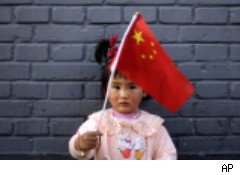 Girl waving chinese flag in Beijing