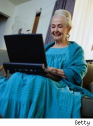 Elderly woman using a computer