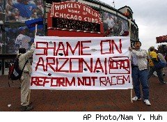 a banner protesting Arizona's controversial new immigration law
