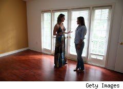 Real Estate agent with home buyer