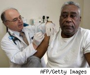 Doctor provides health care to patient