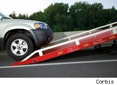 car being loaded on a flatbed