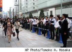 Lines in front of the Apple store in the Ginza district of Tokyo