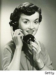 Woman on old style home phone