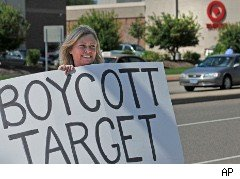 Woman outside a Target store holds boycott sign