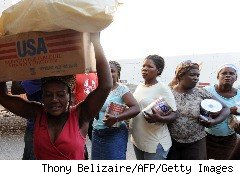 Haitian women line up for food aid.