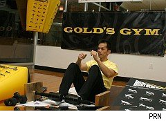Gold's Gym man doing situps