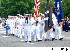 Sailors from Naval Air Station Brunswick march in the local parade for the final time.