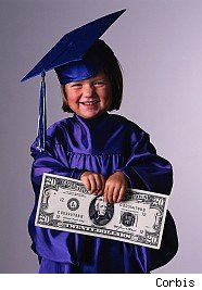 Smiling girl in graduation gown holding $20 bill