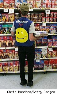 Walmart employee with smiley face logo on vest