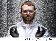 a model poses while flexing a piece of Corning's ultra-strong Gorilla glass