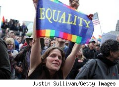 Jana Barber holds a sign during a rally to celebrate the ruling to overturn Prop 8