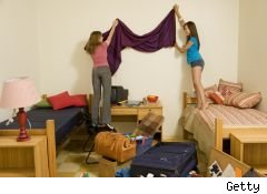 two college girls decorating their dorm room