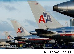 American Airlines planes lined up at a terminal