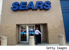 Man enters a Sears store in Brooklyn,. N.Y.