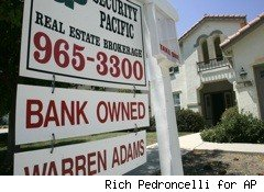 bank-owned for sale sign in front of house - home disclosures