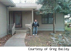 Greg Bailey in front of his new house