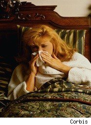 lady in bed with the sniffles - Kleenex